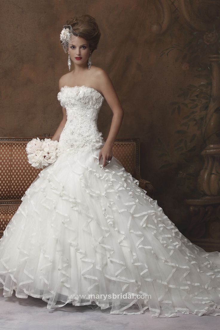 Gown with lots of detailing.