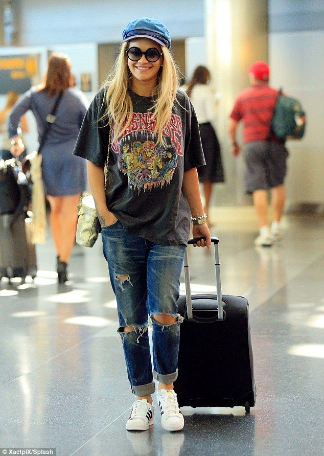 Dressed down: Rita Ora rocked a casual ensemble on Thursday as she caught a flight for JFK...