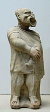 Ancient Greek comedy - Figurine of an actor wearing the mask of a bald-headed man, 2nd century BC