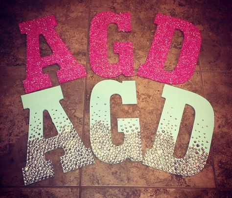 Wooden Letters Sorority Craft.  One is painted and covered in glitter, and the other is painted and decorated with jewels in an ombré style!