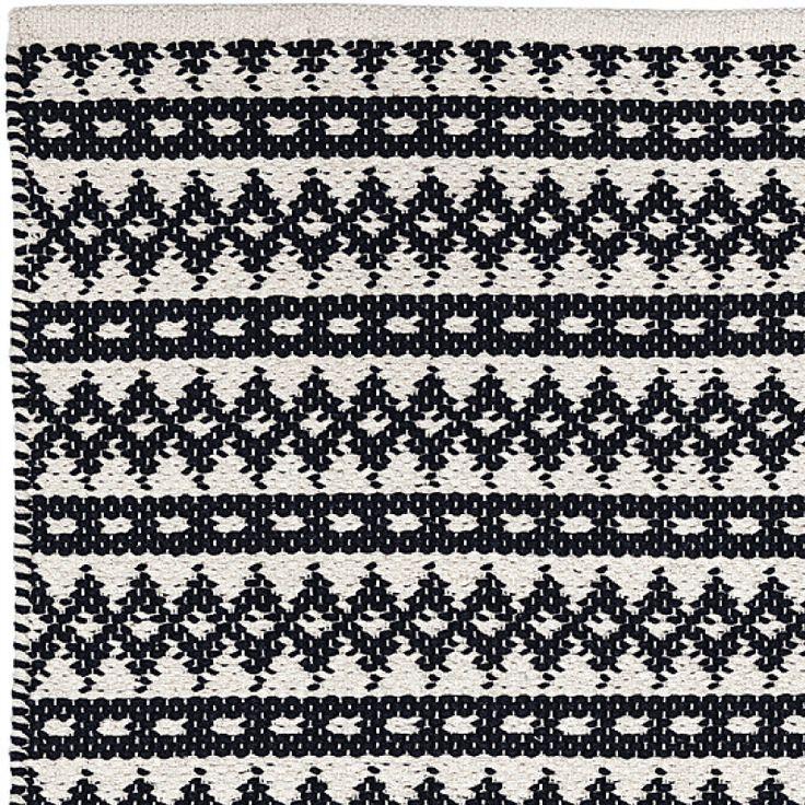 COPENHAGEN in BLACK/ECRU is made of 100% cotton. Perfect for indoor. Available in 55x120cm   70x200cm   140x200cm   200x300cm