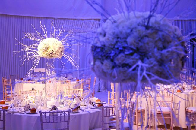 White and silver bare branches make effective and dramatic centrepieces • 4 of the best white winter wedding themes