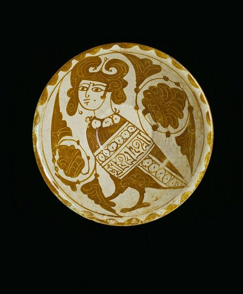1. An Egyptian or Syrian earthenware bowl, 1200-50, depicting a harpy; her wing has a tiraz band with a pseudo-Kufic 'inscription' on it.