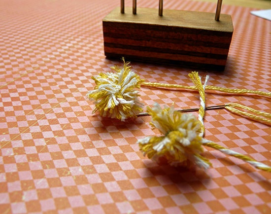 Miniature pompoms from twine tutorial