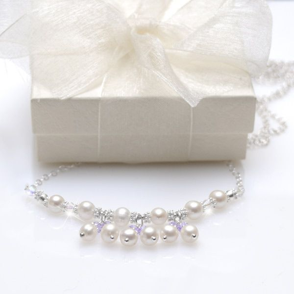 Heavenly Freshwater Pearl Necklace - A beautifully crafted freshwater pearl necklace just perfect for your little one on her special occasion. An enchanting design for 1st Holy Communion but would also make a lovely gift for birthdays or flower girls. A row of lustrous 5-6mm ivory freshwater pearls enhanced with bright sterling silver beads. Dainty freshwater pearl and sparkling 4mm lavender Swarovski crystal drop add so much elegance to this design. Set on a sterling silver chain.