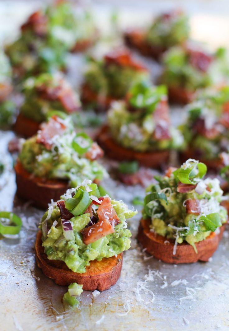 These sweet potato rounds with creamy guacamole and crispy bacon are arguably better than chips — and a lot healthier!