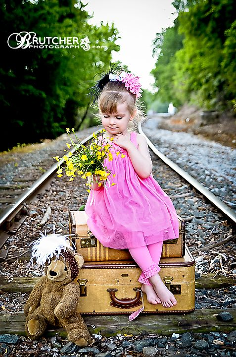 by Peggy Brutcher of Brutcher Photography    pink vintage hats and railroad tracks with vintage suitcases