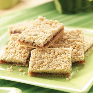 Raspberry Oatmeal Bars Recipe -Cake mix hurries along the prep work for these yummy bars. Raspberry jam adds a pop of color and sweetness, and oats lend a homey touch. —Trish Bosman-Golata, Rock Hill, South Carolina