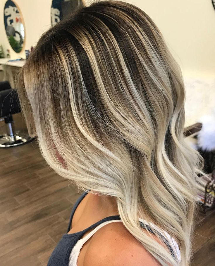 Stunning balayage using contrast and depth to highlight the platinum blonde pieces with a dropped down, dark shadow root. In love.