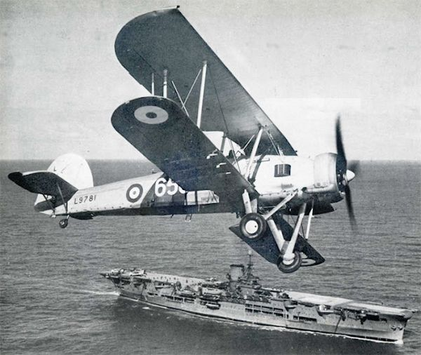 "26 May 41: Outdated British bi-plane Fairey Swordfish torpedo bombers from the HMS ARK ROYAL attack the great German battleship BISMARCK, hitting and jamming her rudder, leaving her running in circles. The BISMARK will be polished off tomorrow and the HMS HOOD will be avenged. Designed in the 1930s and nicknamed the ""Stringbag,"" the Fairey Swordfish bi-plane outlived several types intended to replace it and remained in front line service until V-E Day. #WWII #History"