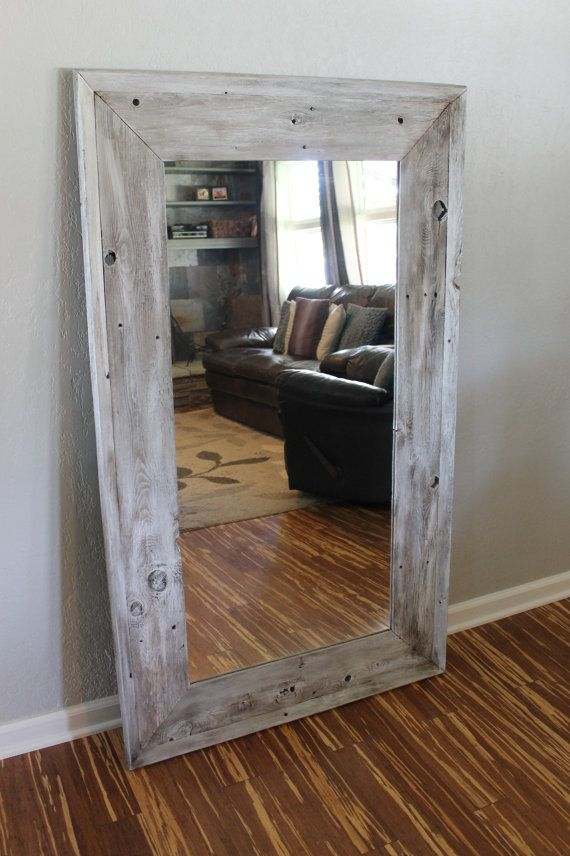 This gorgeous full length floor mirror was handmade using reclaimed, old fence pickets. The corners have a 30* angle on them verses a traditional