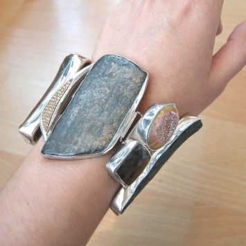 Must have red carpet look! Extra large earthy petrified wood bracelet set in silver.