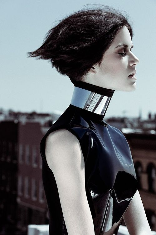 Metallic accents. Strong monochrome. Urban background. Glossy patent silhouette. Silver toned skin.