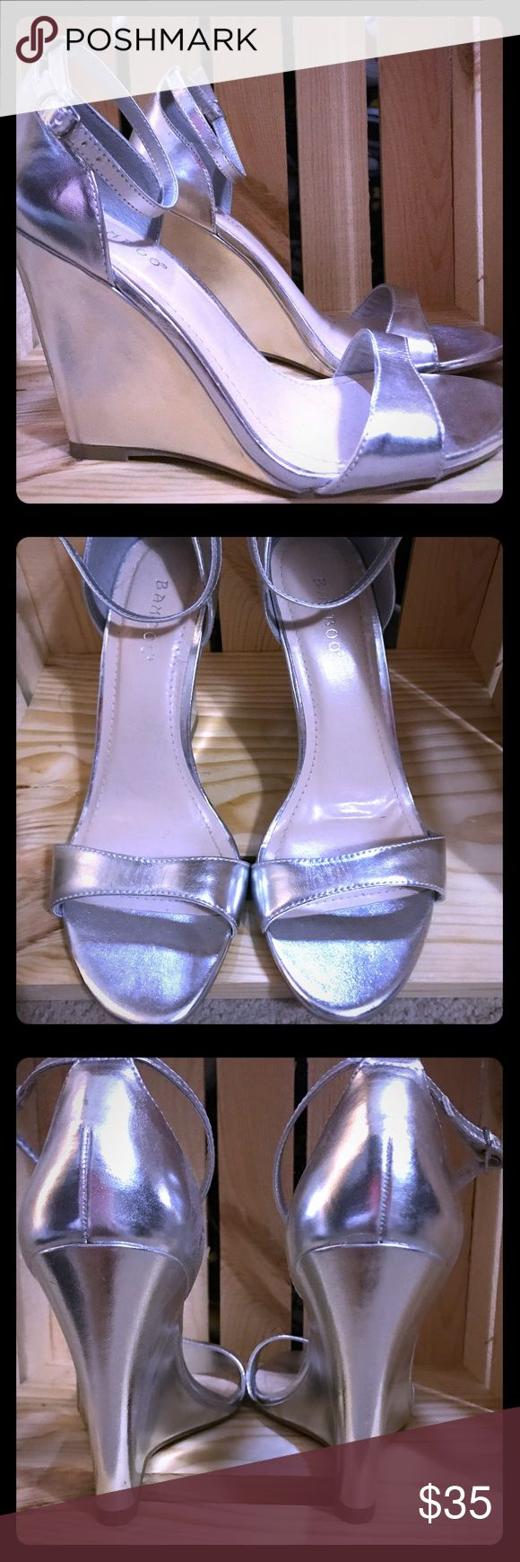 Bamboo brand silver wedge sandals Perfect wedges for summer wedding or prom! Wedge is about 4 inches. Never worn, only tried on. My feet can't handle the tall wedge anymore!  They look a little iridescent in the pictures, but they're silver. Bamboo Shoes Wedges