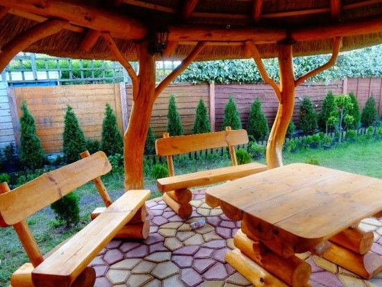 Thatched Roof Log Gazebo with Table. Get tools from: http://toolsforhomeimprovement.com/ to build your Bali Hut.