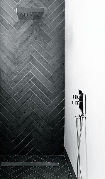 Dyer Grimes Architects | Emperors Gate residence | South Kensington, London. Charcoal gray walk-in shower with herringbone tile pattern and chrome fixtures.