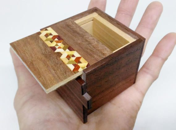 Japanese Puzzle box Himitsu Bako / 2 sun Kobako 7 steps box Outside size : 54 x 54 x 47 mm (inside space 32x35x40 mm) Kobako means a small box in Japanese. This box is opened by 7 steps. This puzzle box have 1 slide key and 2 slide panels. 2sun is Japanese Measure,1sun is