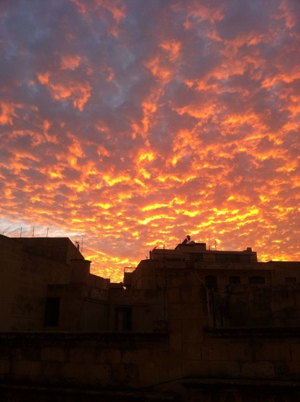 Sliema, Malta — by mackanfkp. Got home from work and saw this burning sky from my window in Sliema, Malta. #sunset #sky #iphone
