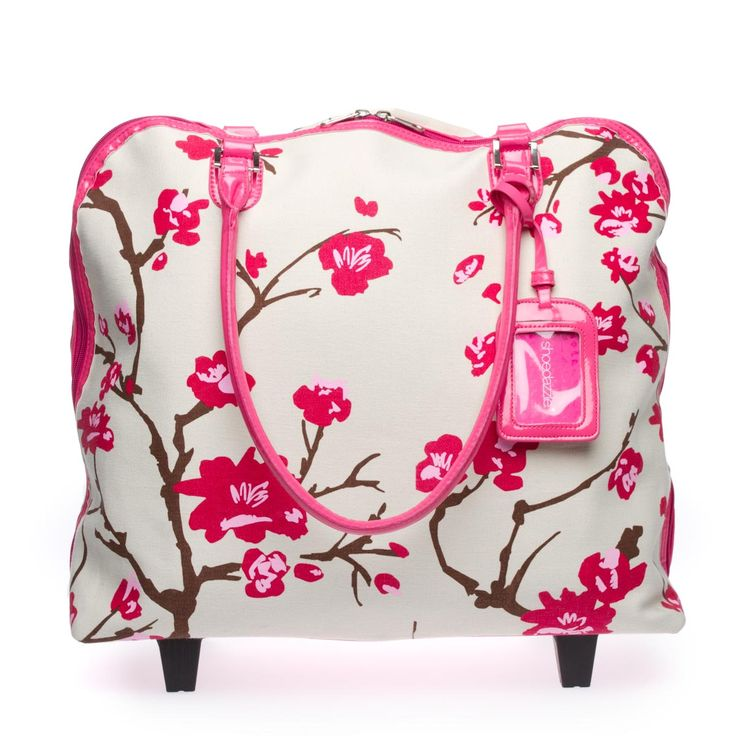NEW ARRIVAL!    Breeze through airport crowds with this eye-catching roller bag, which was made for weekend getaways.     DESIGN DETAIL: Beautiful floral-print fabric will ensure no one mistakes your luggage for theirs.