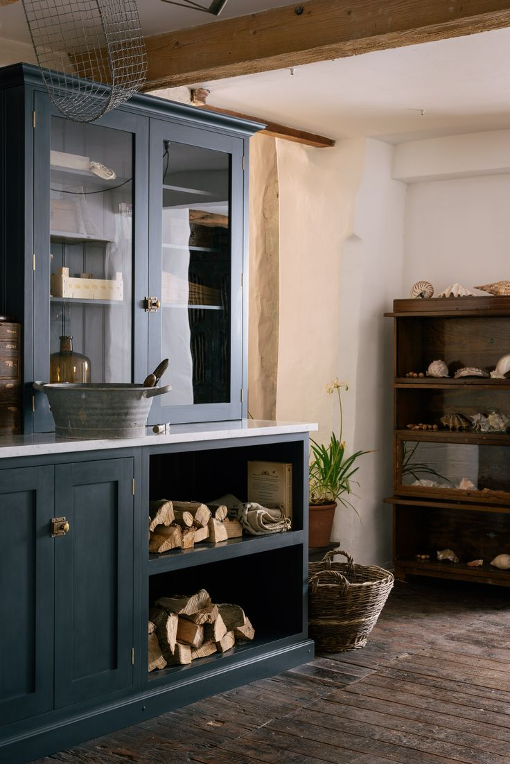 A very beautiful and very practical utility room by deVOL, painted in dark blue with brass details.