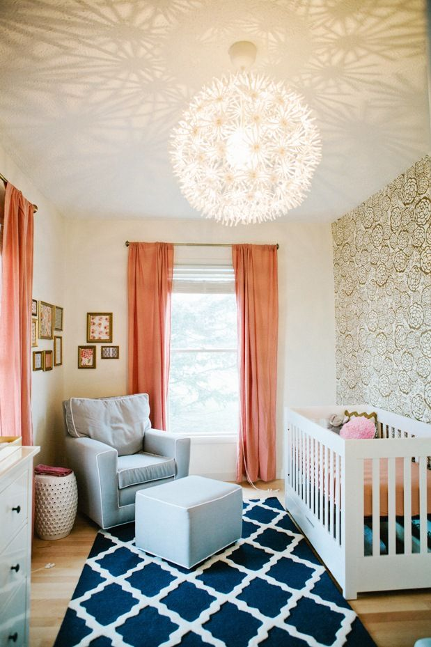 i like the light fixture. coral color. wall paper. the rug is probably too contrasting for me since there isn't navy elsewhere