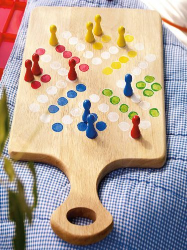 Homemade board game! Very cute and original!  i like the idea of using a wooden cutting board.