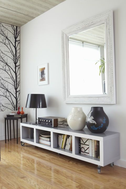 Double the amount of light in your room by hanging mirrors, which allow sunlight to bounce off reflective surfaces. It's best to hang a large mirror directly across from the largest window in your room, or you can arrangean array ofsmaller mirrors tohelp brighten a dark staircase.