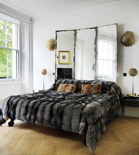 I've got to find me one of those faux fur comforters!! So cozy!! (in a chocolate brown)
