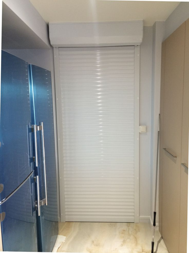RSG5100 continental door security shutter fitted to a residential apartment in Belsize Grove, North London.