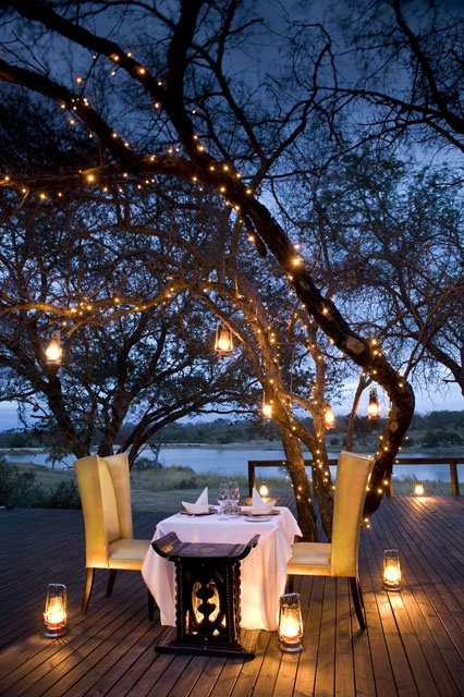 Romantic dinner setting with lanterns
