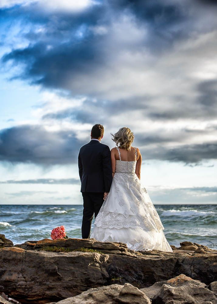 Bride and groom overlooking the ocean on the Mornington Peninsula