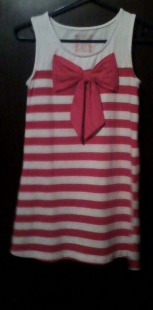 Red and white dress striped with red bow on front. Cute :-)