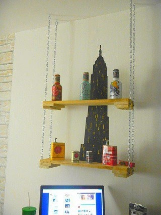 Pallet Shelf with Chains and very cute wall mural sitting on it.