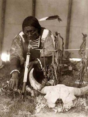 Lakota man, pipe ceremony, 1907, Edward S. Curtis by lesley