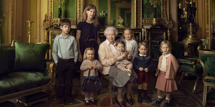 She poses with her grandchildren, corgis and daughter Princess Anne.