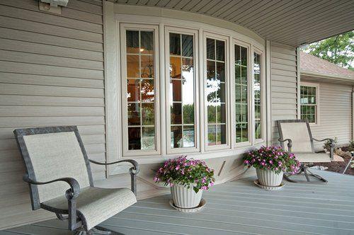 Bow windows overlooking backyard.