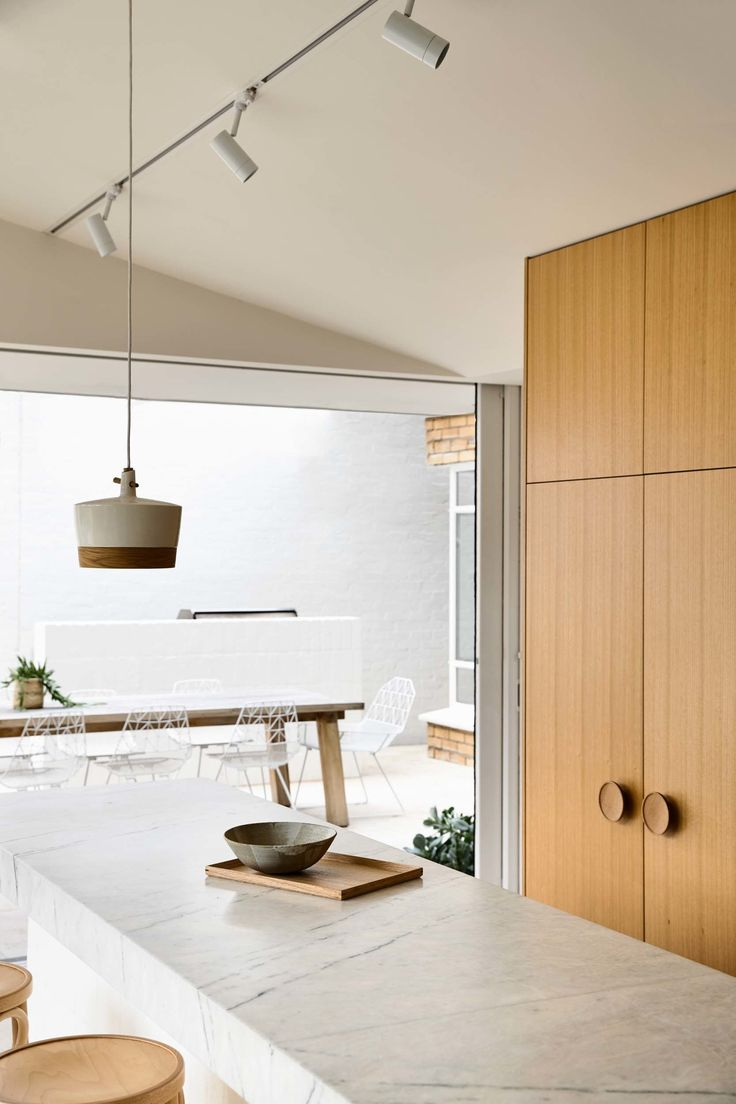 White track lighting ensuring that this beautiful kitchen has ample light so that the Australian Made Ceramic Pendant Light can shine in all its beauty Derek Swalwell Photography KNA_Maitland_60.jpg (1600×2400)