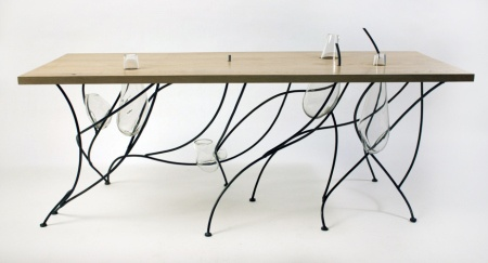 The table embodies three different materials: wood, glass and metal, and is inspired by Japanese rock gardens with glass vessels breaking up the tabletop surface, doubling as functional containers. / #design #art #table #furniture #desk