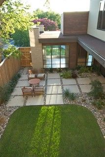 Pavers and river rock patio, fence, and see through front to back windows.  In love.