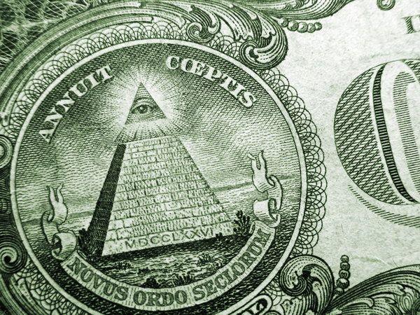 Американский долларпо сей день хранит свои загадки. В самом значке доллара видят обозначение испанских пиастров, Геркулесовы столбы и ветхозаветного змия.