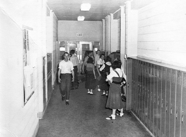 Cruising the halls of a vintage high school, complete with cuffed jeans and saddle shoes. #vintage #school #students