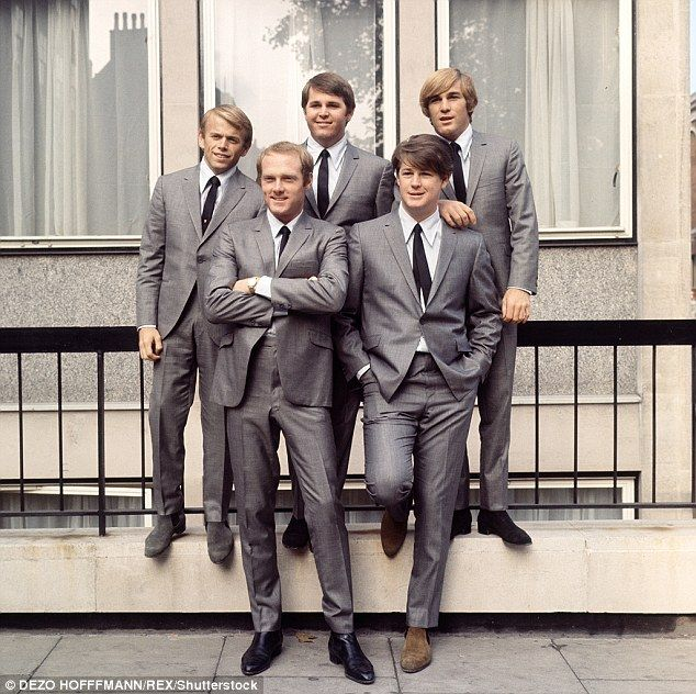 Wilson (front right) was a member of the Beach Boys. The group is pictured above in 1964 f...