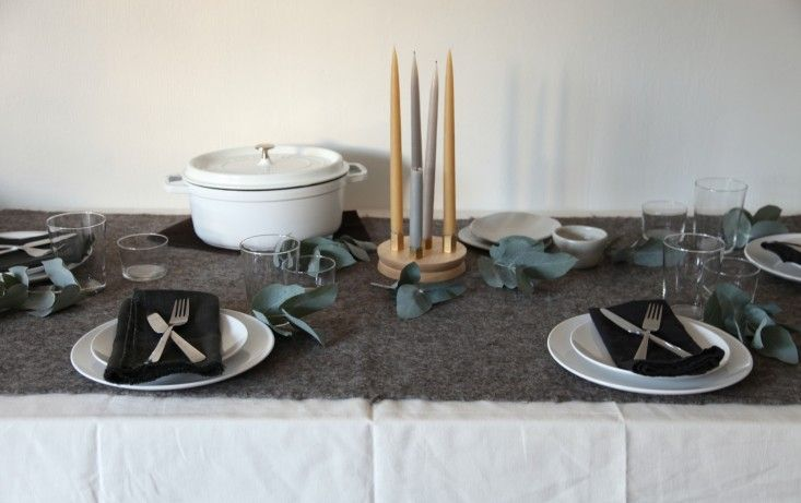 A Nordic Table Setting with Copper Pipes Used as Candle Holders | Remodelista