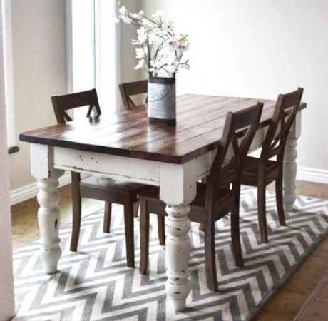 Nice classy farmhouse style dining table on a fun ziggy patterned rug.