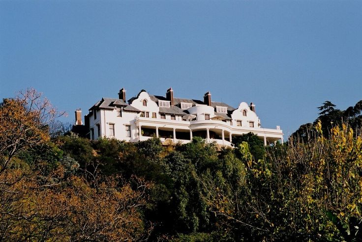 Exterior of a century old Johannesburg mansion with large imposing rooms and impressive architectural detail.