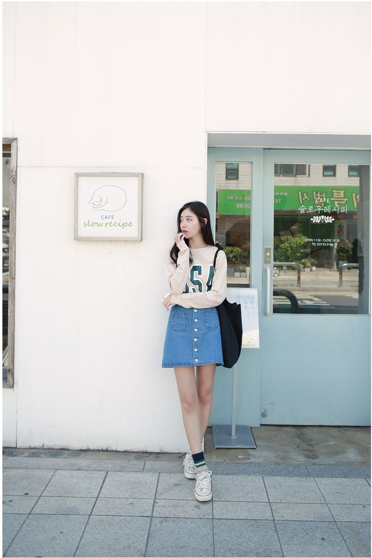 the universal button down skirt, goes especially well with a light/slim sweater