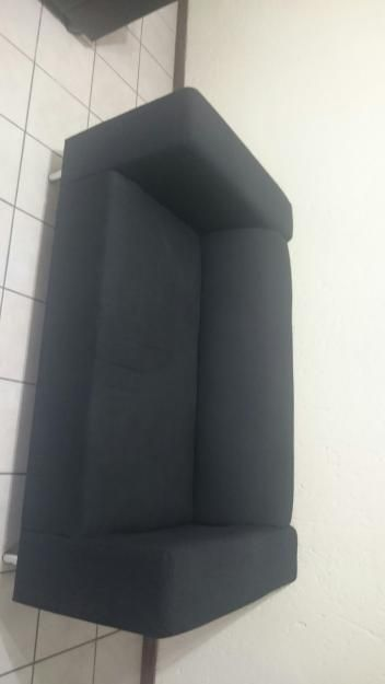 2 seater black material couch