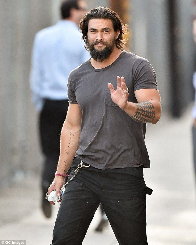 Ahhhh Holy shat... Jason Momoa. Keeping it casual: He sported a dark grey T-shirt with black trousers