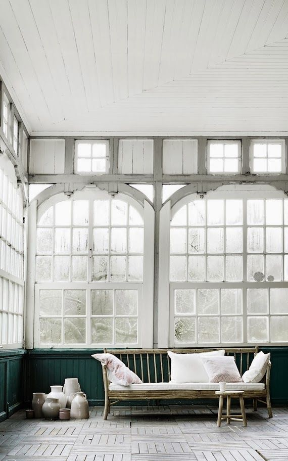 Look at the wonderful details of these windows...and then glance at the parquet floor all done in the same white as the windows. SIGH. Lovely and serene.