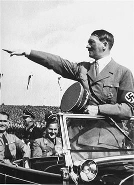 Adolf Hitler salutes the ranks of German youth from his car. - Picture from the USHMM, courtesy of Richard Freimark.